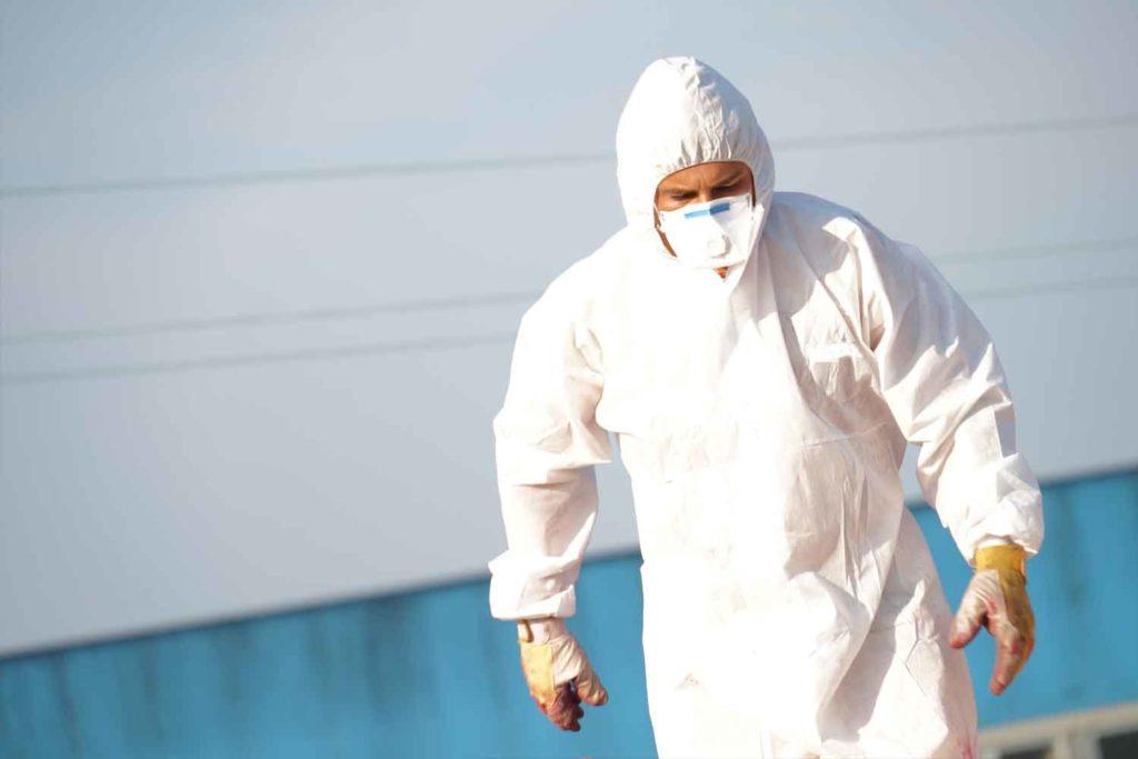 calgary asbestos removal company - Asbestos Removal man in protective gear
