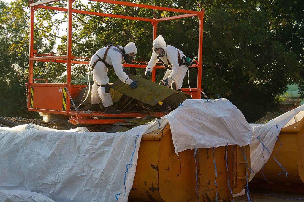 calgary asbestos removal company - Asbestos Removal men on lift